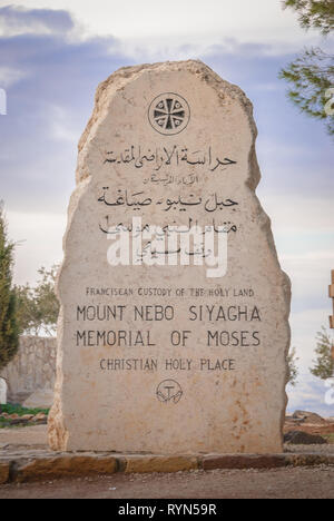 Stone at the entrance of the Nebo Mount with inscription Franciscan custody of the Holy Land, Mount Nebo Siyagha Memorial of Moses, Christian holy pla - Stock Photo