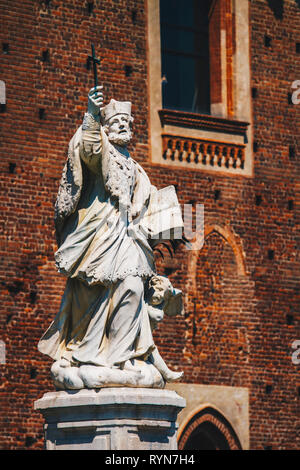 View at statue of John of Nepomuk in Sforza Castle in Milan, Italy - Stock Photo