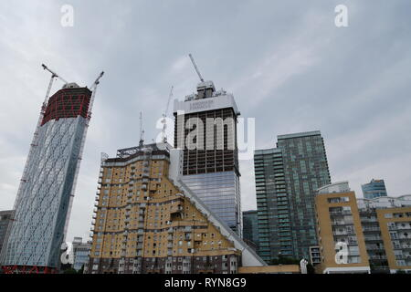 Construction of the high-rise apartment blocks, Newfoundland and the Landmark Pinnacle, amongst other buildings on Canary Wharf in London city, UK. - Stock Photo
