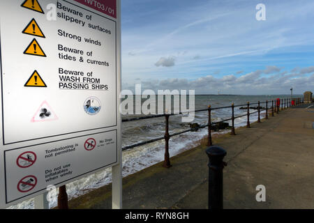 warning sign,beware of wash from, ships,strong,winds,slippery,surfaces,tides, currents,passing,tombstoing,not, permitted,no,dogs, Gurnard, Isle of Wig - Stock Photo