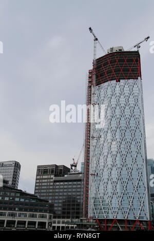The modern residential high-rise apartment complex, Newfoundland, under construction on Canary Wharf in London, United Kingdom. - Stock Photo