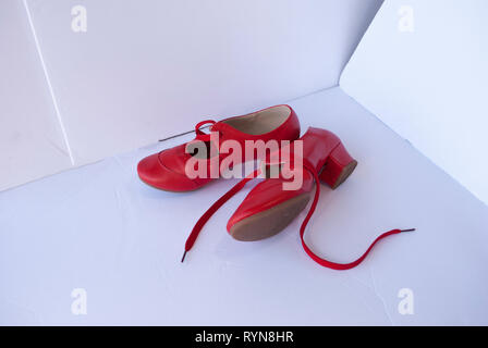 Red leather pair of shoes for female dancer. Traditional retro style footwear - Stock Photo