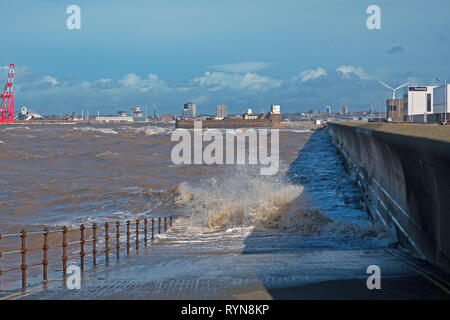 Huge waves crash over the sea wall at New Brighton Merseyside UK - Stock Photo