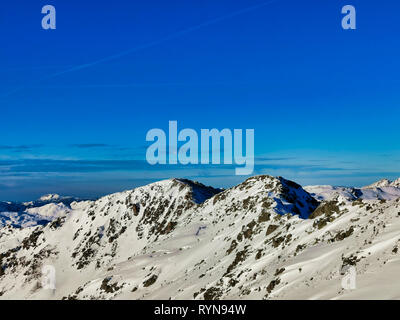panoramic mountain view in the Austrian Alps against clear blue sky - Stock Photo