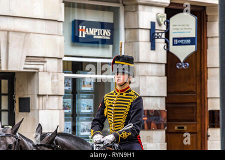 A trooper from The King's Troop Royal Horse Artillery on horseback near Sloane Square in London on their way to a Trooping of The Colour rehearsal - Stock Photo