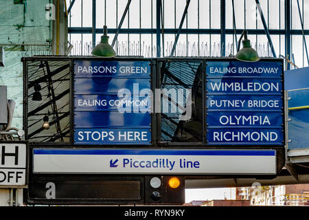 Tain indicator boards at Earls Court Underground Station , SW London - Stock Photo