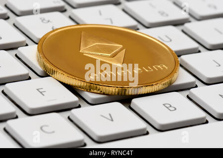 cryptocurrency, virtual currency ethereum, on keyboard - Stock Photo