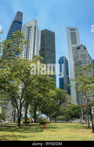 View towards Raffles Place from Empress Lawn, Singapore - Stock Photo