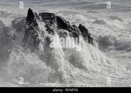 Sao Paio small cape after severely hit by stormy waves. Northern portuguese coast during winter. - Stock Photo