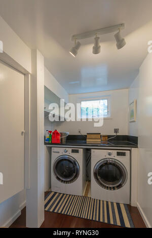 Laundry room interior washer and dryer - Stock Photo