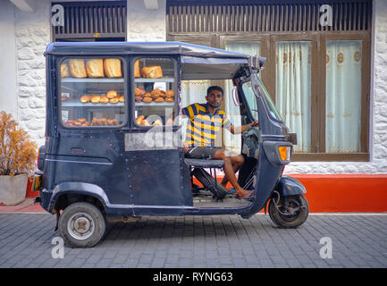 Bread delivery man in black tuktuk in the old part of Galle . Galle, Sri Lanka, January 9 2018 - Stock Photo