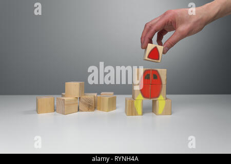 Wooden blocks with rocket illustration. Start up business launch success concept - Stock Photo