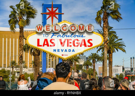 LAS VEGAS, NV, USA - FEBRUARY 2019: People queuing to have their picture taken in front of the famous 'Welcome to Las Vegas' sign. - Stock Photo