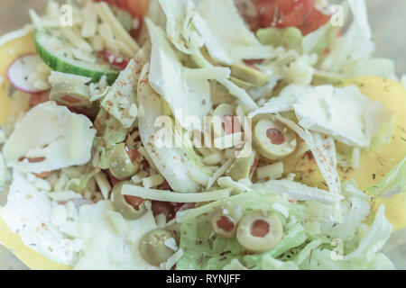 Fresh cheese and mixed vegetable salad close up.Bright and blurred soft image of healthy and nutritious food.Perfect summer meal idea.Flat layout. - Stock Photo