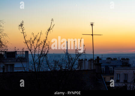 Sunset in Paris, view of the roof of houses and Eiffel Tower. View from Basilica Sacre Coeur. - Stock Photo