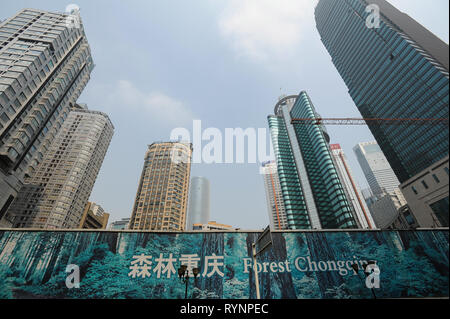 03.08.2012, Chongqing, China, Asia - A view of a construction site with modern high-rise buildings in the city centre of the megacity. - Stock Photo