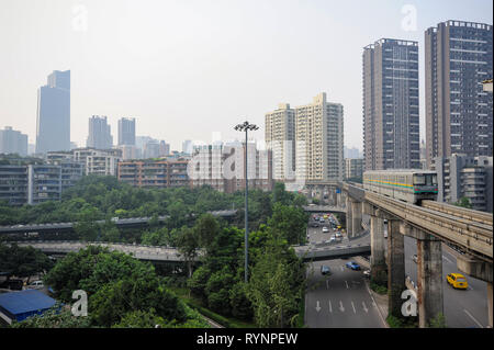 03.08.2012, Chongqing, China, Asia - Cityscape with residential high-rise buildings and elevated railway in the outskirts of the metropolis. - Stock Photo