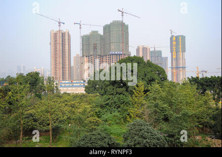03.08.2012, Chongqing, China, Asia - View of a construction site with new high-rise apartment buildings outside the city centre. - Stock Photo