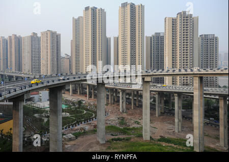 03.08.2012, Chongqing, China, Asia - New high-rise housing development and elevated motorways in the outskirts of the metropolis. - Stock Photo