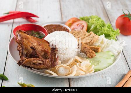 Nasi lemak kukus with fried chicken, popular traditional Malaysian local food. - Stock Photo