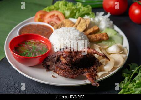 Nasi lemak kukus with quail meat, popular traditional Malaysian local food. - Stock Photo