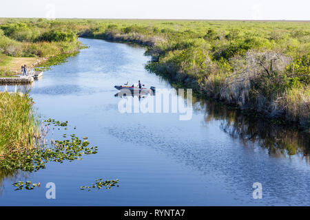 Florida, FL, South, Collier County, Everglades, Big Cypress National Preserve, Alligator Alley, Interstate 75, wetlands, canal, bass boat, motorboat, - Stock Photo