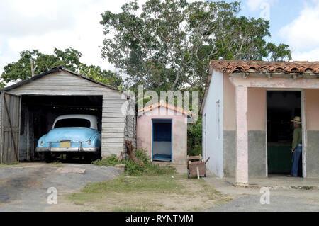 Vinales Pinar Del Rio,Cuba-September 23, 2016: Vintage car in a garage next to a small farmhouse in Vinales Pinar del Río Province Cuba Latin America - Stock Photo