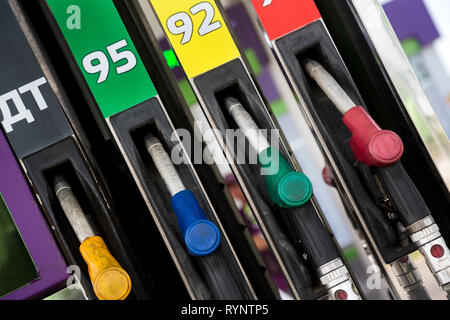 Filling guns with gasoline of different octane numbers and diesel fuel for cars at a gas station in Moscow,, Russia - Stock Photo