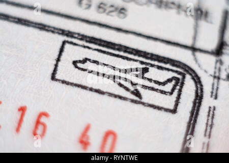 Close-up macro detail of European Union border control customs admission stamp with airplane symbol in focus - Stock Photo