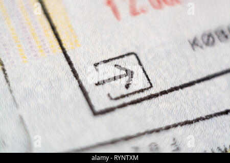 Close-up macro detail of European Union border control customs admission stamp with enter symbol in focus - Stock Photo
