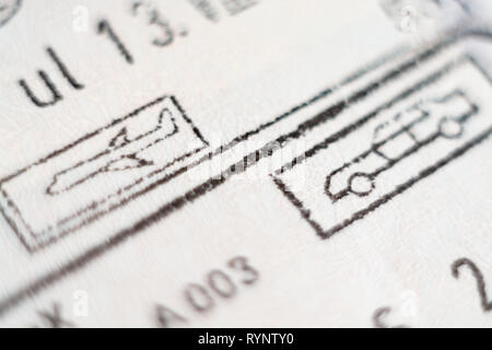Close-up macro detail of European Union border control customs admission stamps with car and airplane symbol in focus - Stock Photo