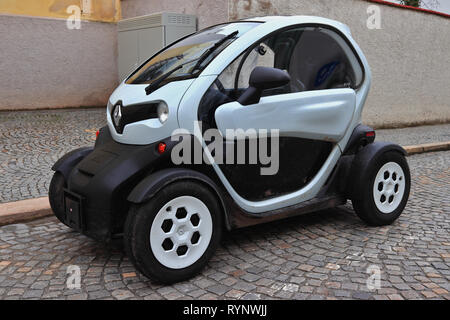 Renault Twizy electric car. European compact concept car parked on an old cobblestone street. Zero emission ecological vehicle. - Stock Photo