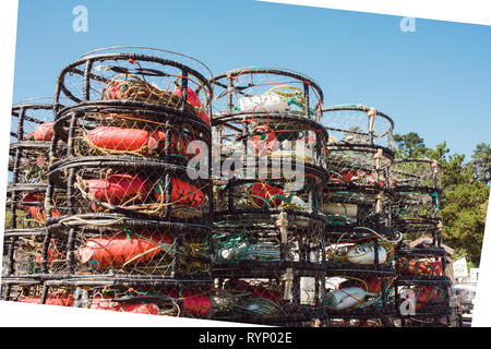 Boats and fishing supplies at rest in the harbor at Ft. Bragg, California. - Stock Photo