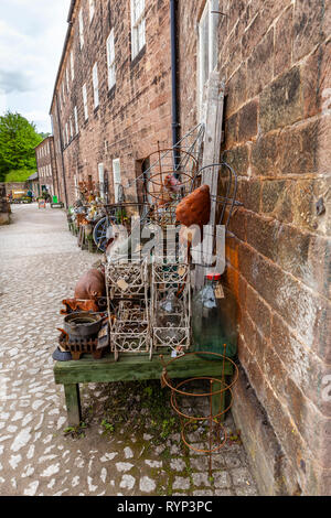 Cromford mill is in Derbyshire, England, And has the bric-a-brac shop, with a lot of the goods on display outside.