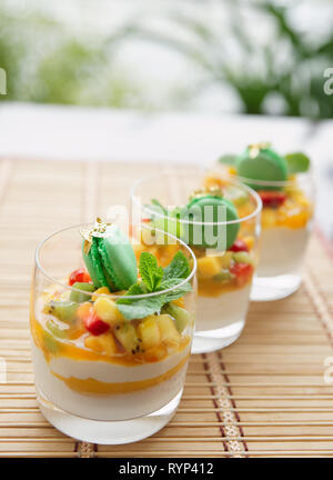 Three fruit cocktails on a summer restaurant lounge, copy space - Stock Photo