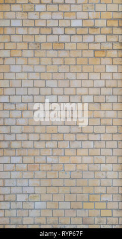 Full frame background of detailed old light yellow brick wall. - Stock Photo