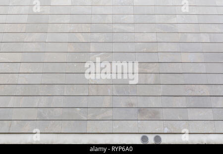 Full frame background of a new, modern and clean stone wall or building exterior. - Stock Photo