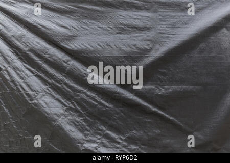 Full frame background of a wrinkled gray tarp texture - Stock Photo