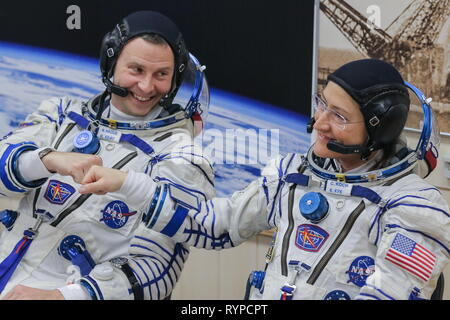 Kazakhstan. 14th Mar, 2019. KYZYLORDA REGION, KAZAKHSTAN - MARCH 14, 2019: NASA astronauts Nick Hague and Christina H. Koch of the ISS Expedition 59/60 prime crew during a spacesuit check before a launch to the International Space Station. The launch of a Soyuz-FG booster rocket carrying the Soyuz MS-12 spacecraft to the ISS from the Baikonur Cosmodrome is scheduled for March 14, 2019 at 22:14 Moscow time. Sergei Savostyanov/TASS Credit: ITAR-TASS News Agency/Alamy Live News - Stock Photo