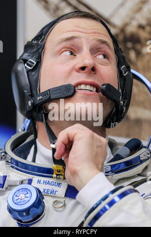Kazakhstan. 14th Mar, 2019. KYZYLORDA REGION, KAZAKHSTAN - MARCH 14, 2019: NASA astronaut Nick Hague of the ISS Expedition 59/60 prime crew during a spacesuit check before a launch to the International Space Station. The launch of a Soyuz-FG booster rocket carrying the Soyuz MS-12 spacecraft to the ISS from the Baikonur Cosmodrome is scheduled for March 14, 2019 at 22:14 Moscow time. Sergei Savostyanov/TASS Credit: ITAR-TASS News Agency/Alamy Live News - Stock Photo