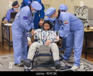 Kazakhstan. 14th Mar, 2019. KYZYLORDA REGION, KAZAKHSTAN - MARCH 14, 2019: NASA astronaut Christina H. Koch of the ISS Expedition 59/60 prime crew during a spacesuit check before a launch to the International Space Station. The launch of a Soyuz-FG booster rocket carrying the Soyuz MS-12 spacecraft to the ISS from the Baikonur Cosmodrome is scheduled for March 14, 2019 at 22:14 Moscow time. Sergei Savostyanov/TASS Credit: ITAR-TASS News Agency/Alamy Live News - Stock Photo