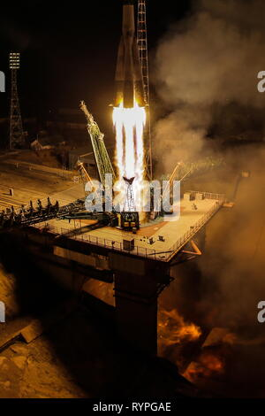 Kazakhstan. 14th Mar, 2019. KYZYLORDA REGION, KAZAKHSTAN - MARCH 14, 2019: A Soyuz-FG rocket booster carrying the Soyuz MS-12 spacecraft with Roscosmos cosmonaut Alexei Ovchinin, NASA astronauts Nick Hague and Christina H. Koch of the ISS Expedition 59/60 prime crew aboard lifts off to the International Space Station (ISS) from the Baikonur Cosmodrome. Sergei Savostyanov/TASS Credit: ITAR-TASS News Agency/Alamy Live News - Stock Photo