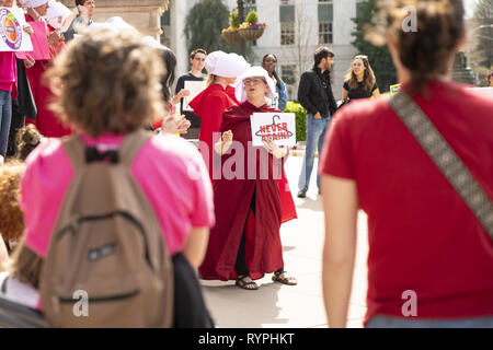 Atlanta, Georgia, USA. 14th Mar, 2019. Dozens of pro-choice protesters demonstrated against the ''heartbeat bill'' legislation at the Georgia State Capitol building. The legislation would ban most abortions after six weeks. The protest was organized by several groups including Handmaids Unite - Georgia. Several protesters dressed as characters from the book The Handmaid's Tale. Credit: Steve Eberhardt/ZUMA Wire/Alamy Live News