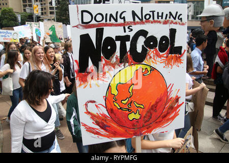 Sydney, Australia. 15th March 2019. School children and other activists protested at Sydney Town Hall for action on climate change and then marched along Park Street to Hyde Park. Credit: Richard Milnes/Alamy Live News - Stock Photo