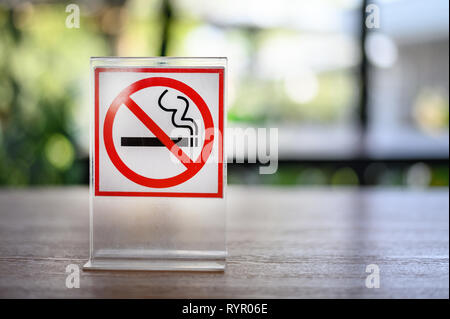 No smoking sign on wooden table in coffee shop Don't smoking place in public - Stock Photo