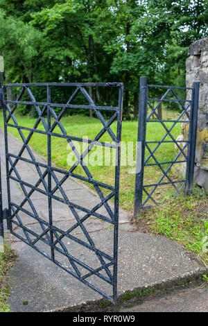 Forged star of David on the open entrance gate to the jewish cemetery of Švenčionys, Lithuania - Stock Photo