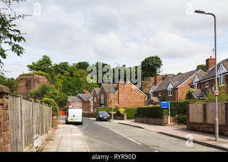 The Old Quarry, a road in Woolton, Liverpool with houses nestling in a disused red sandstone quarry, this being the south quarry of two adjacent worki - Stock Photo