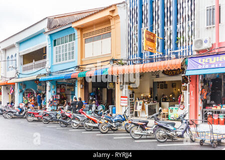 Phuket, Thailand - 11th April 2017: Motorcycles parked outside shops on Thalang Road. This is one of the main streets in the old town. - Stock Photo