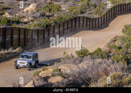 Border Patrol vehicle dragging tires to erase tracks, to facilitate detection of illegals by their tracks in road, Jacumba California, April 2018, - Stock Photo