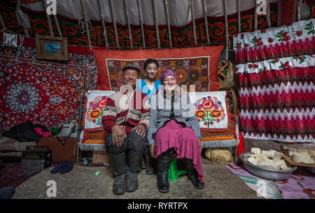 Bayan Olgii, Mongolia, 29th September 2015: Mongoilian family in their home yurt - Stock Photo